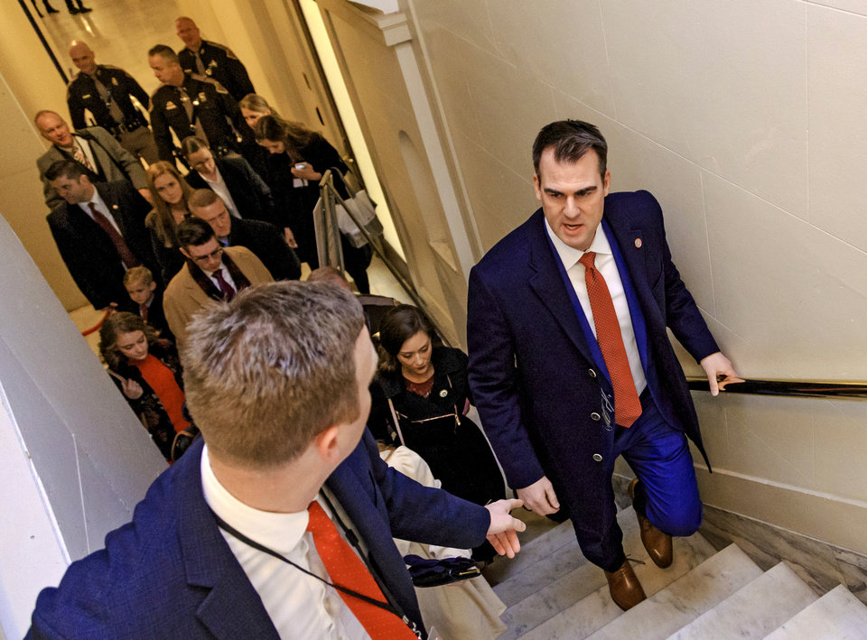 Photo - Gov. elect Kevin Stitt arrives with his family for his inauguration ceremony  at the Oklahoma State Capitol in Oklahoma City, Okla. on Monday, Jan. 14, 2019.  Photo by Chris Landsberger, The Oklahoman