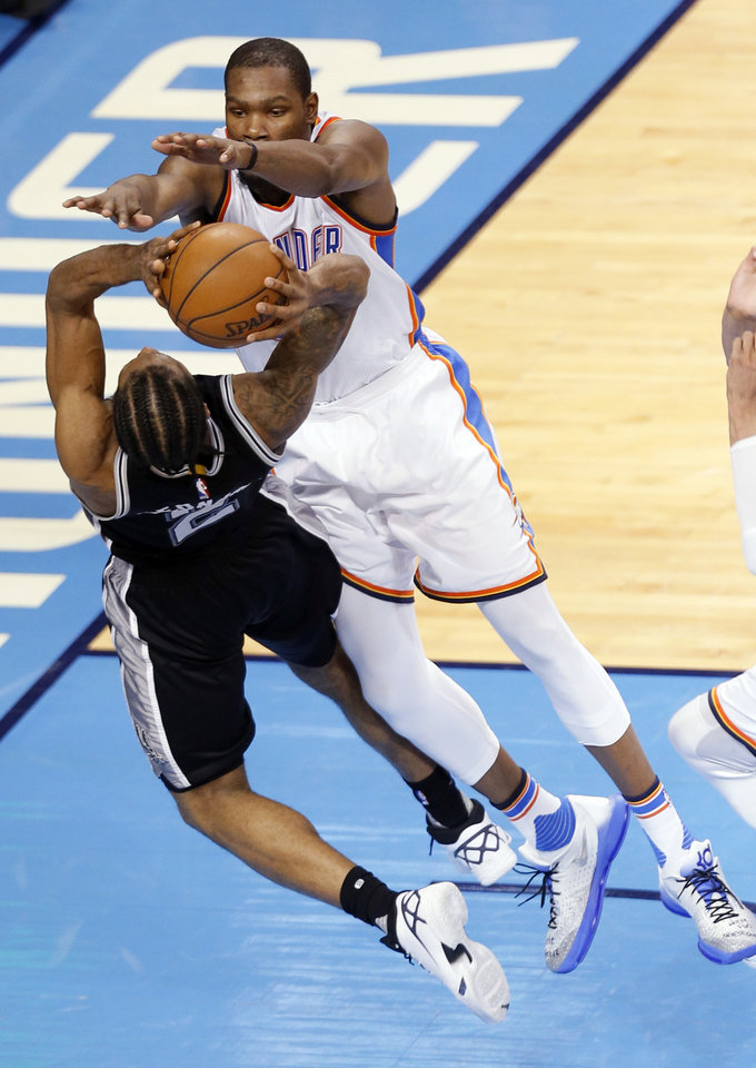Photo - Oklahoma City's Kevin Durant (35) defends against San Antonio's Kawhi Leonard (2)in the fourth quarter during Game 6 of the Western Conference semifinals between the Oklahoma City Thunder and the San Antonio Spurs in the NBA playoffs at Chesapeake Energy Arena in Oklahoma City, Thursday, May 12, 2016. Photo by Sarah Phipps, The Oklahoman