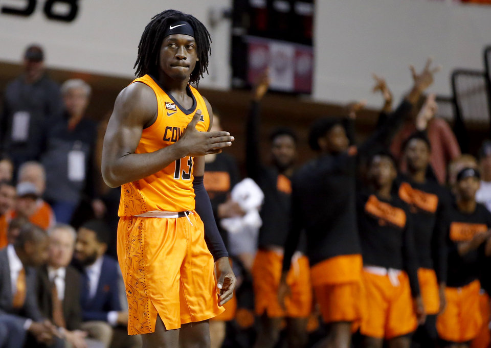 Photo - Oklahoma State's Isaac Likekele (13) gestures during an NCAA basketball game between the Oklahoma State University Cowboys (OSU) and the Oral Roberts Golden Eagles (ORU) at Gallagher-Iba Arena in Stillwater, Okla., Wednesday, Nov. 6, 2019. Oklahoma State won 80-75. [Bryan Terry/The Oklahoman]