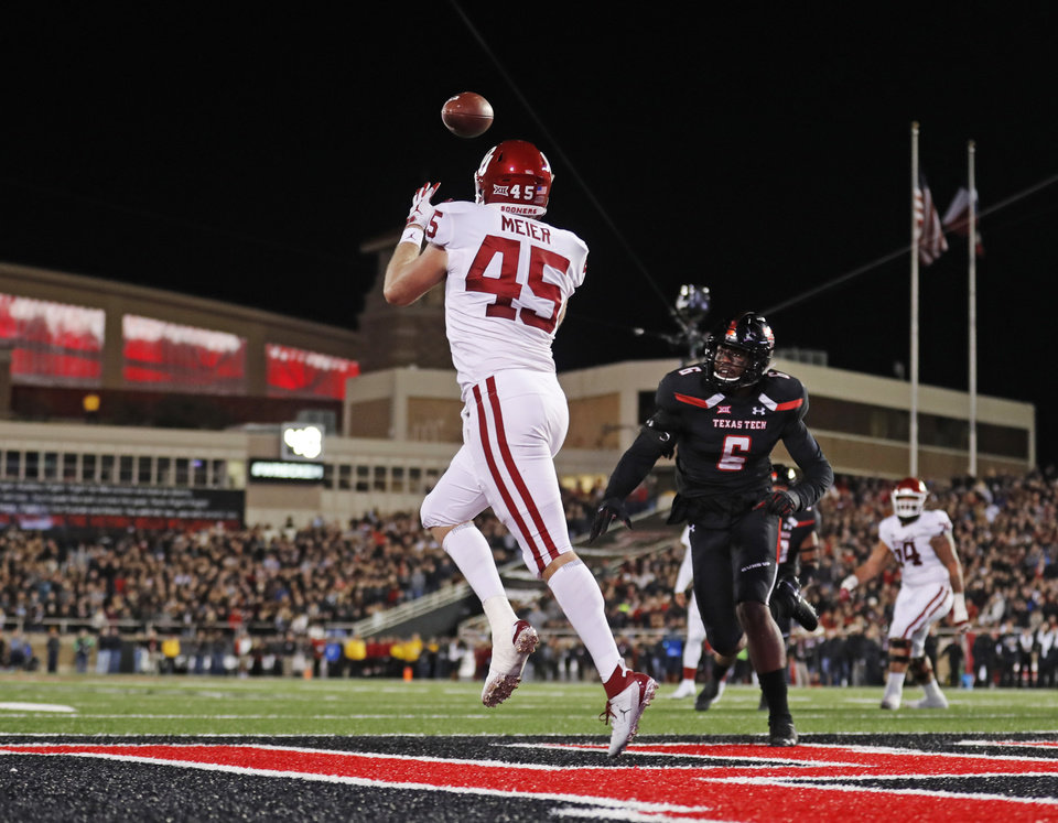 Photo - Oklahoma's Carson Meier (45) catches the ball for a touchdown during the first half of an NCAA college football game against Texas Tech, Saturday, Nov. 3, 2018, in Lubbock, Texas. (AP Photo/Brad Tollefson)