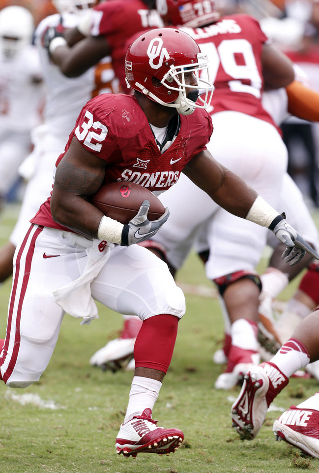 Photo - Oklahoma's Samaje Perine (32) carries during the Red River Showdown college football game between the University of Oklahoma Sooners (OU) and the University of Texas Longhorns (UT) at the Cotton Bowl in Dallas, Texas on Saturday, Oct. 11, 2014.  Photo by Steve Sisney, The Oklahoman