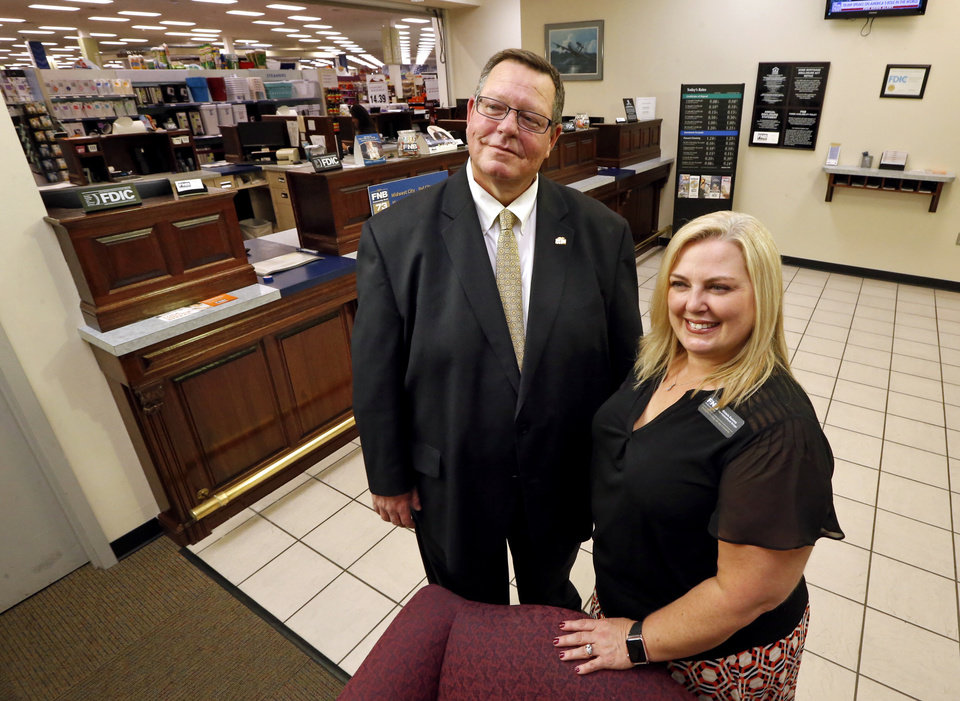 Photo -  Bill Croak, president and CEO of FNB Community Bank, and branch manager Michelle Devinney show the bank's BX branch on Tinker Air Force Base. [Photo by Steve Sisney, The Oklahoman]