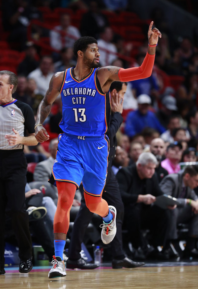 Photo - Oklahoma City Thunder forward Paul George celebrates after scoring during the second half of an NBA basketball game against the Miami Heat, Friday, Feb. 1, 2019, in Miami. (AP Photo/Wilfredo Lee)