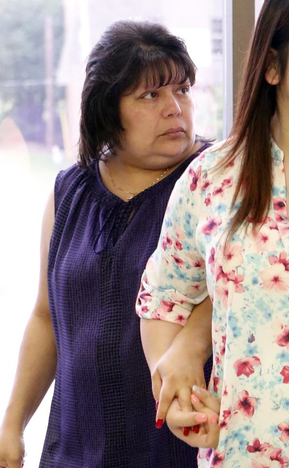 Photo - Housekeeper Rose Marie Chavez leaves the courtroom after testifying in the triple murder case of defendant Alan Hruby on Tuesday, June 16, 2015 in Duncan, Okla. Photo by Steve Sisney, The Oklahoman