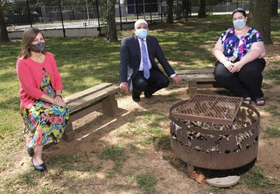 Photo -  Rabbi Vered Harris, Imad Enchassi, senior imam of the Islamic Society of Greater Oklahoma City, and Abby Jacobson, spiritual leader of Emanuel Synagogue, pose for a photo on the grounds of Temple B'nai Israel in Oklahoma City, where Harris is spiritual leader. [Doug Hoke/The Oklahoman]