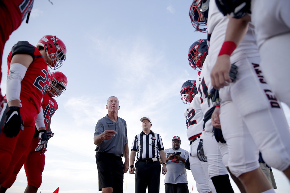 Photo - Gary Rose throws the coin flip before the high school football game between Carl Albert and Del City at Carl Albert High School in Midwest City, Okla., Friday, Sept. 13, 2019. [Sarah Phipps/The Oklahoman]