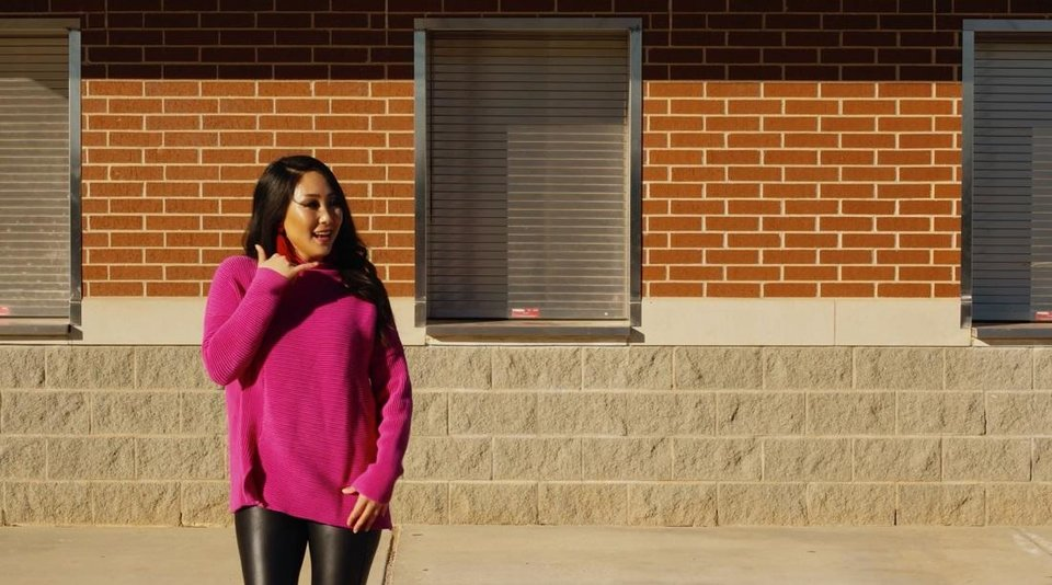 Photo - Jaclyn Gass, of Midwest City, is featured outside Carl Albert High School in the primetime inaugural special