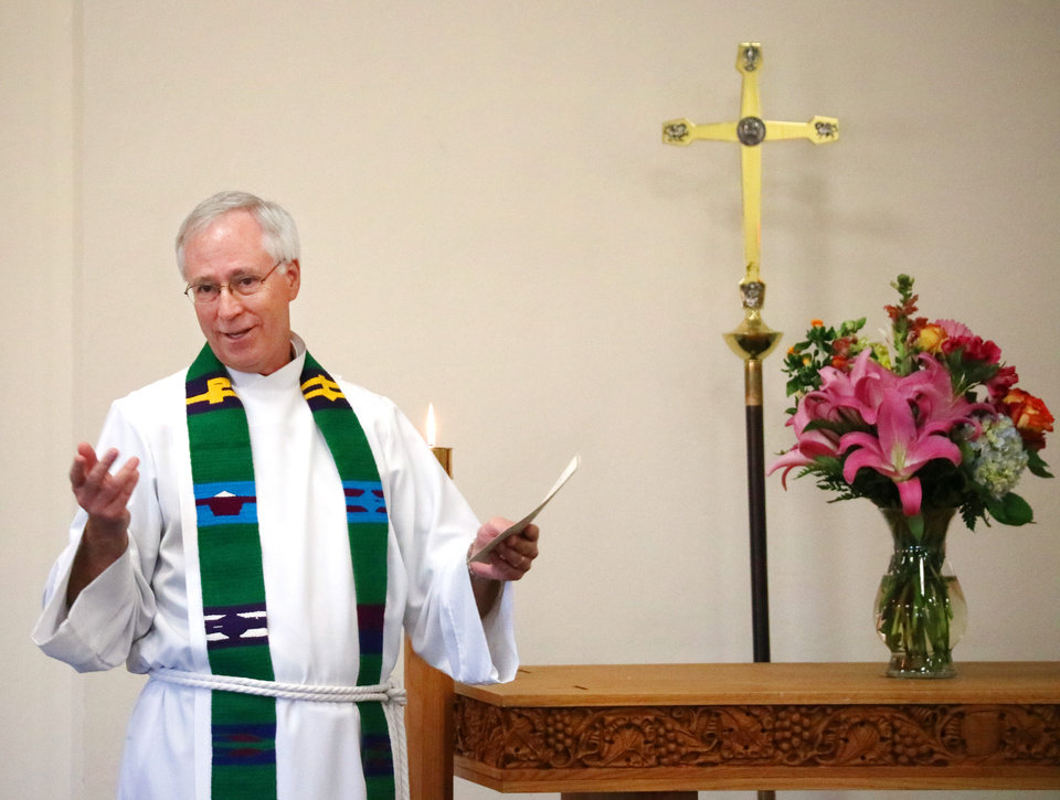 Photo -  The Rev. Mark Story presents the homily during the anniversary celebration at St. Mary's Episcopal School in Edmond. [Photo by Doug Hoke, The Oklahoman]