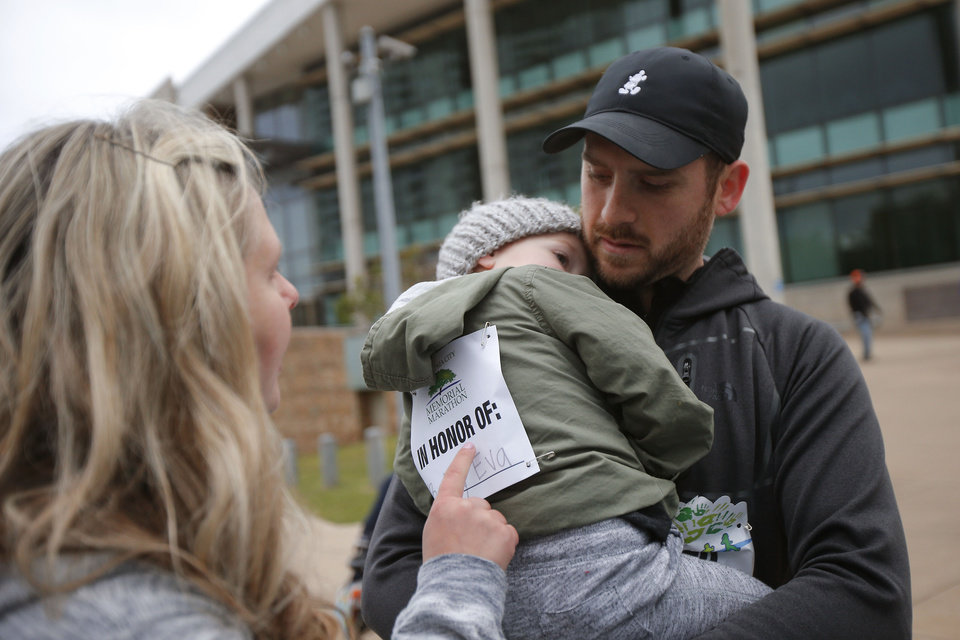Photo -  Royce and Keri Young with their son Harrison, age 2, get ready to walk in the children's portion of the Oklahoma City Memorial Marathon on Sunday. [PHOTO BY BRYAN TERRY, THE OKLAHOMAN]