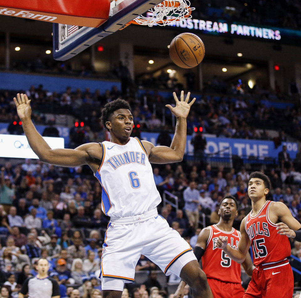 Photo - Oklahoma City's Hamidou Diallo (6) dunks the ball as Chicago's Bobby Portis (5) and Chandler Hutchison (15) look on during an NBA basketball game between the Chicago Bulls and the Oklahoma City Thunder at Chesapeake Energy Arena in Oklahoma City, Monday, Dec. 17, 2018. Oklahoma City won 121-96. Photo by Nate Billings, The Oklahoman
