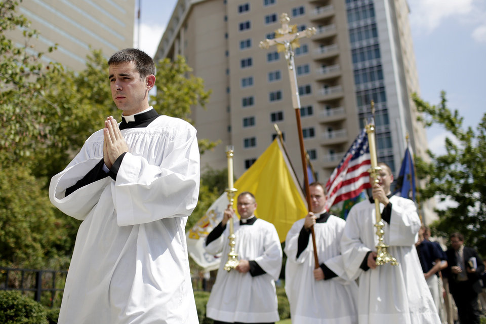 Photo - The Society of St. Pius X holds a rosary procession in downtown Oklahoma City in protest of the Black Mass, Sunday, Sept. 21, 2014.  Photo by Garett Fisbeck, For The Oklahoman