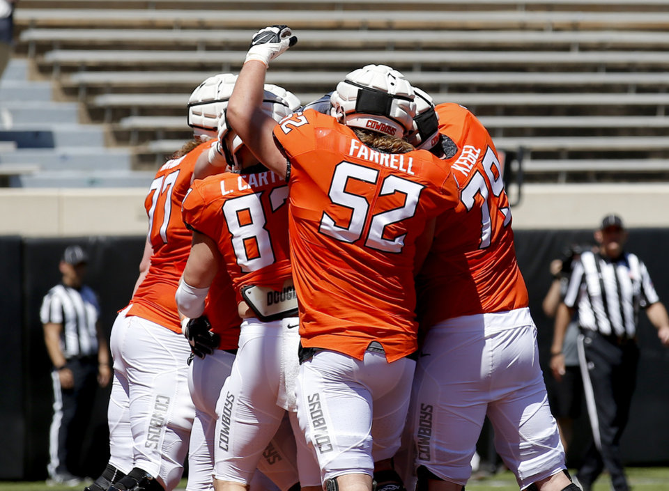 Photo - OSU offense celebrates a score during a 2-minute drill during the Oklahoma State Cowboys spring practice at Boone Pickens Stadium in Stillwater, Okla., Saturday, April 20, 2019.  Photo by Sarah Phipps, The Oklahoman