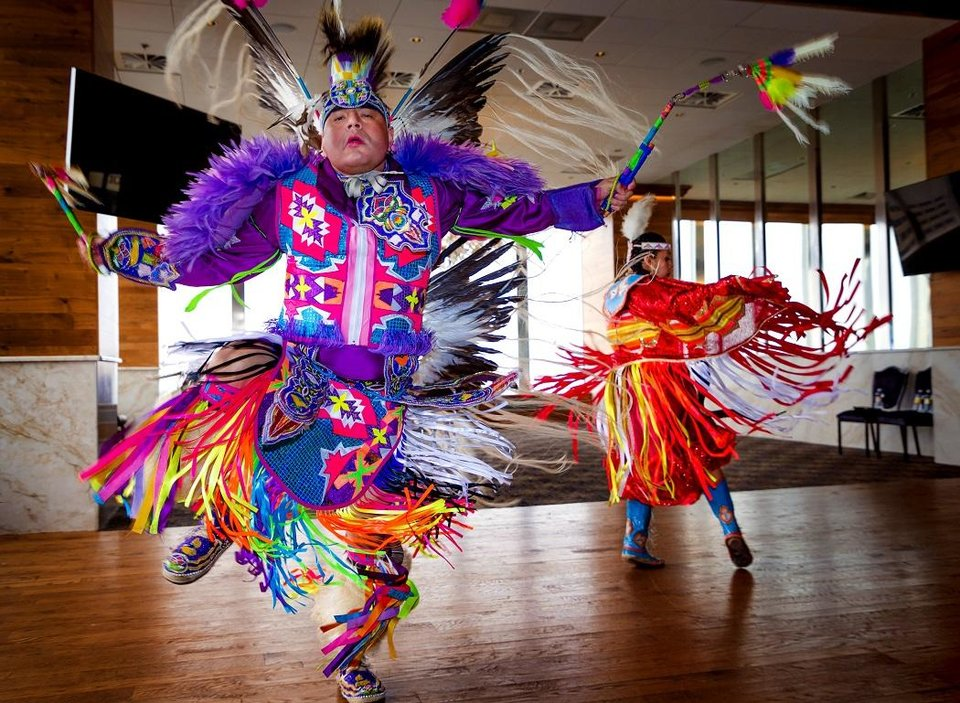 Photo - Native American dancers Cecil Gray and Courtney Reeder perform during a Red Earth press conference at the Petroleum Club in Oklahoma City, Okla. on Monday, Feb. 17, 2020. The news conference announced a new location for the annual Red Earth Festival, a new fall event to mark Oklahoma City's Indigenous Peoples Day and the launch of arts events around the state. [Chris Landsberger/The Oklahoman]