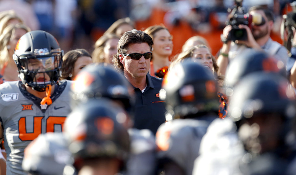 Photo - Oklahoma State head coach Mike Gundy runs onto the field before the college football game between the Oklahoma State Cowboys and the McNeese State Cowboys at Boone Pickens Stadium in Stillwater, Okla., Saturday, Sept. 7, 2019. [Sarah Phipps/The Oklahoman]