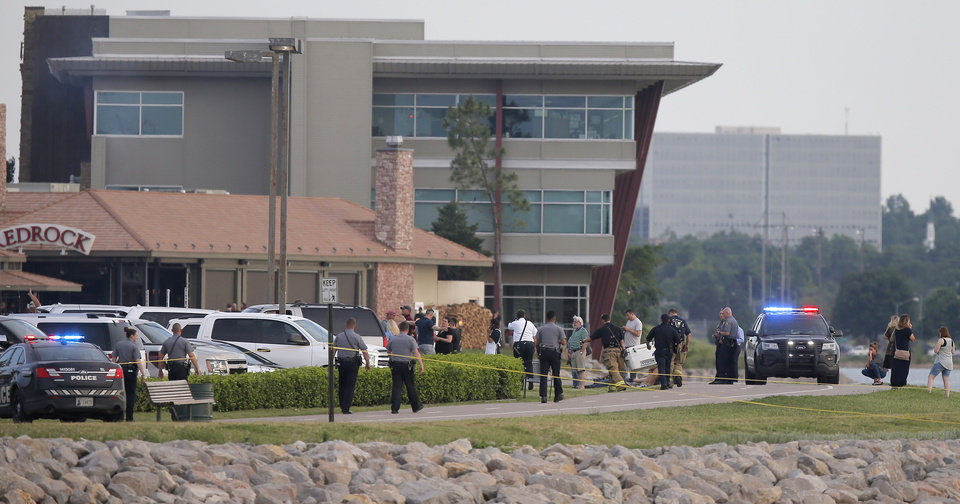 Photo - Police and emergency personal surround the scene of a shooting on the east side of Lake Hefner in Oklahoma City, Thursday, May 24, 2018. Photo by Bryan Terry, The Oklahoman