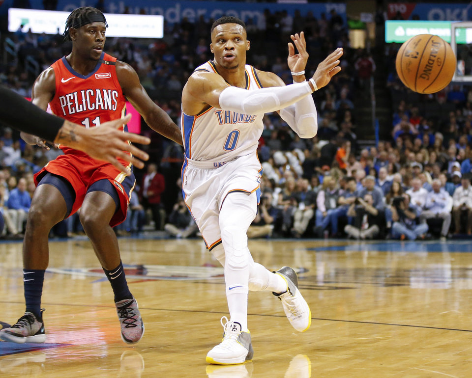 Photo -  Oklahoma City's Russell Westbrook (0) passes away from New Orleans' Jrue Holiday (11) at Chesapeake Energy Arena on Nov. 5. [Photo by Nate Billings, The Oklahoman]