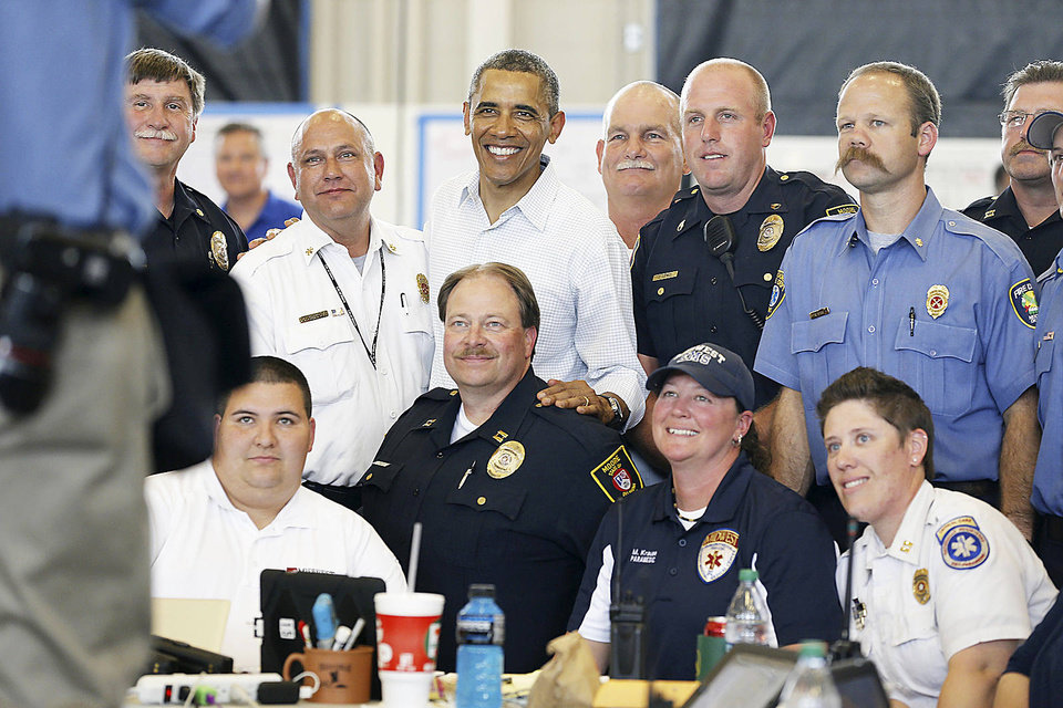 Photo - President Barack Obama greets first responders Sunday at a fire station in Moore.