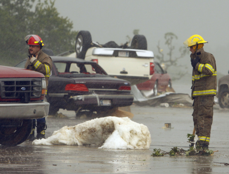 Photo - Overturned cars litter the parking lot of the Country Boy grocery store in Little Axe after a storm tore through the area on Monday, May 10, 2010, in Norman, Okla.  Photo by Steve Sisney, The Oklahoman