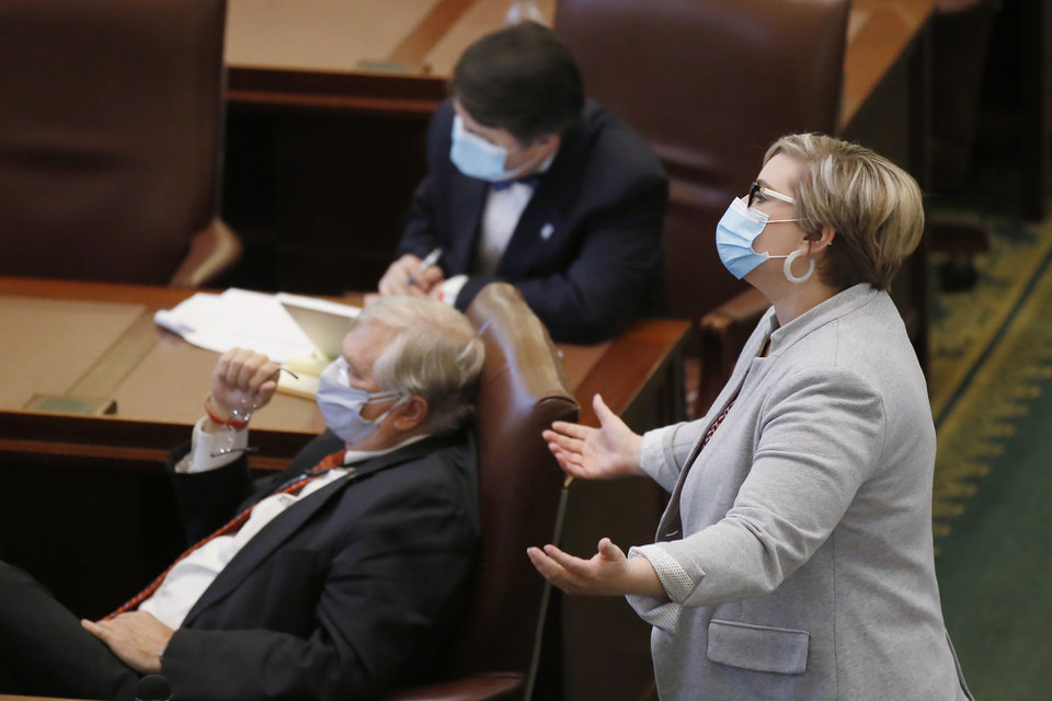 Photo - Oklahoma state Rep. Emily Virgin, D-Norman, gestures on the House floor Wednesday, May 6, 2020, in Oklahoma City Just days after the Oklahoma Supreme Court ruled absentee ballots in Oklahoma don't need to be notarized, the House on Wednesday passed a bill imposing new restrictions on voters who cast ballots by mail. (AP Photo/Sue Ogrocki)