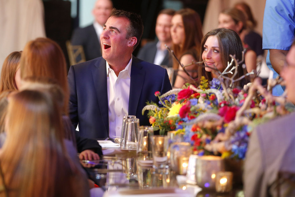 Photo - Gov.-elect Kevin Stitt and his wife Sarah Stitt sit a table during the Lawton Preinaugural Bison Bash in Lawton, Okla., Thursday, Jan. 10, 2019. Photo by Bryan Terry, The Oklahoman