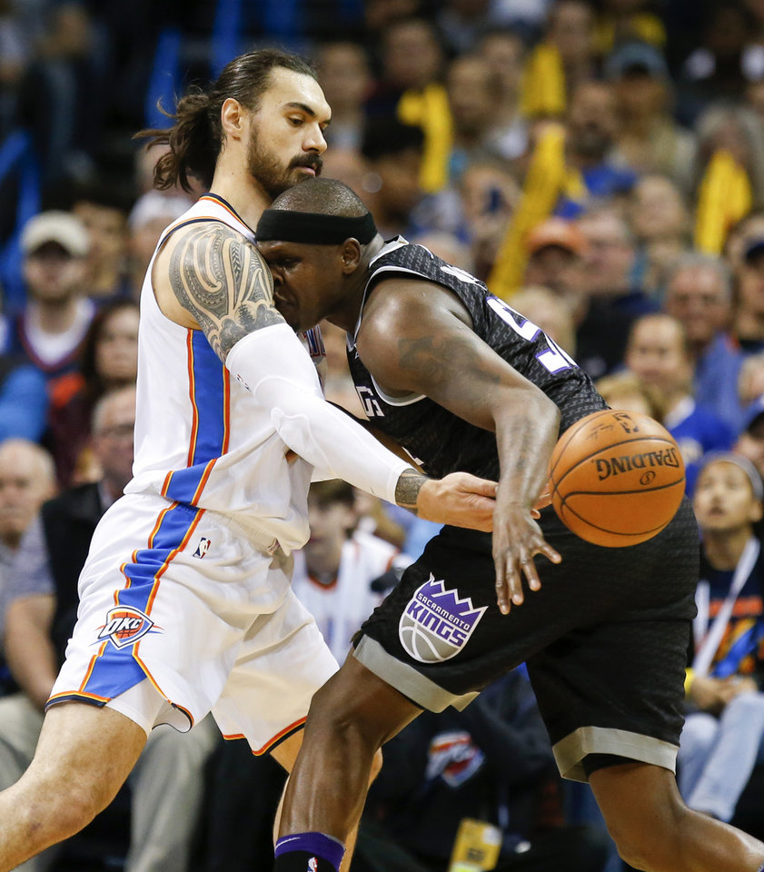 Photo -  Oklahoma City's Steven Adams defends Sacramento's Zach Randolph during Monday's game. [Photo by Nate Billings, The Oklahoman]