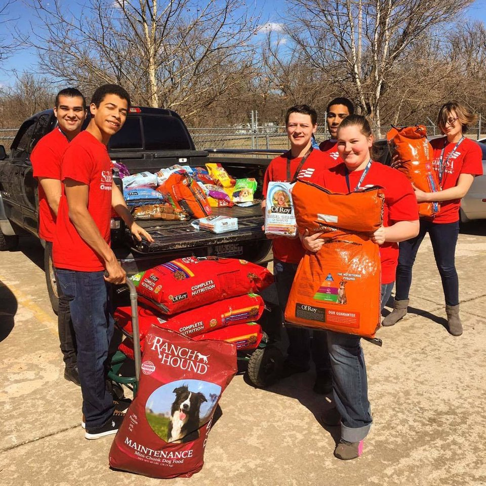 Photo -  Career Exploration Education students at Moore Norman Technology Center unload pet supplies they purchased for Second Chance Animal Sanctuary in Norman. [PHOTO PROVIDED]