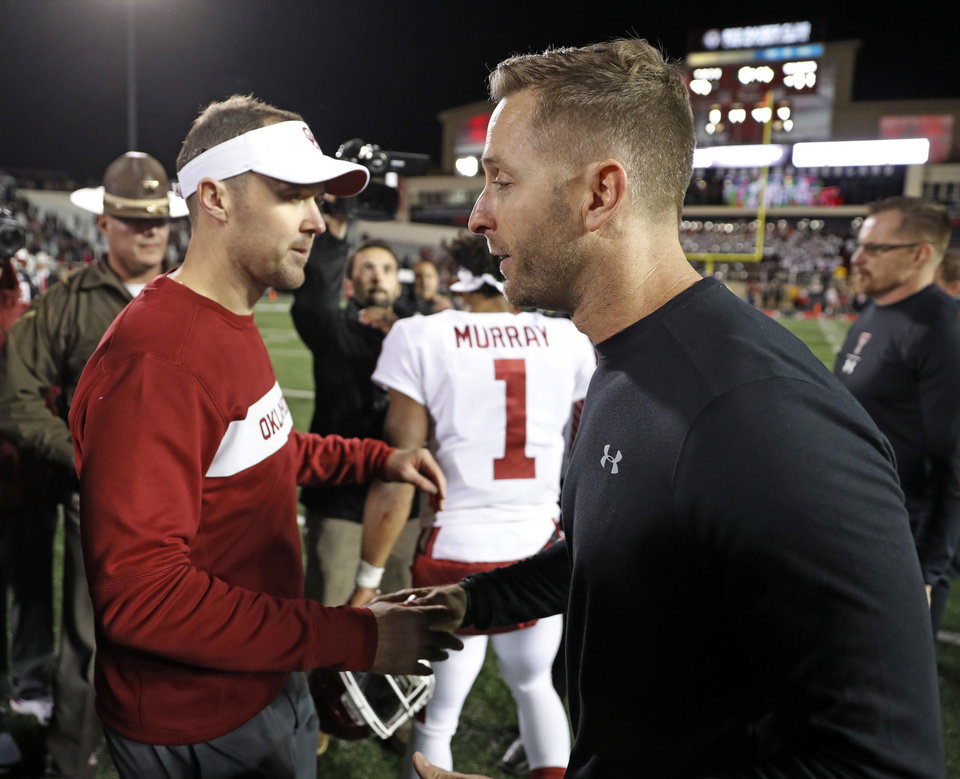 Photo - Oklahoma coach Lincoln Riley, left, shakes hands with Texas Tech coach Kliff Kingsbury after an NCAA college football game Saturday, Nov. 3, 2018, in Lubbock, Texas. (AP Photo/Brad Tollefson)