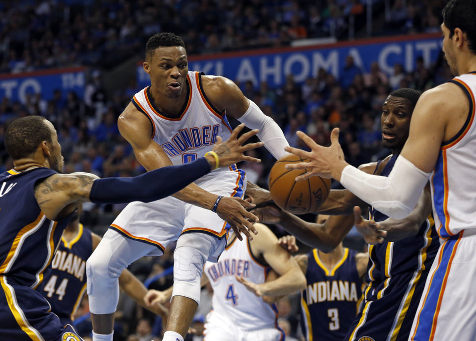 Photo - Oklahoma City Thunder's Russell Westbrook (0) passes to Enes Kanter (11) under the basket in the second half of an NBA basketball game where the Oklahoma City Thunder lost to the Indiana Pacers 101-98 at the Chesapeake Energy Arena in Oklahoma City, on Feb. 19, 2016.  Photo by Steve Sisney The Oklahoman
