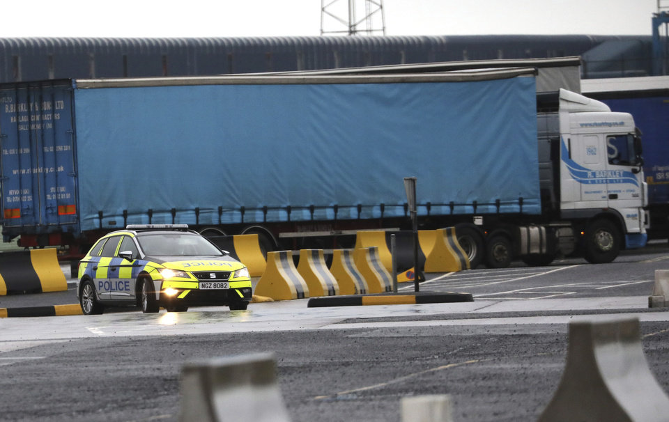 Photo -  Police patrol the port of Larne, Northern Ireland, Tuesday, Feb. 2, 2021. Authorities in Northern Ireland have suspended checks on animal products and withdrawn workers from two ports after threats against border staff. (AP Photo/Peter Morrison)
