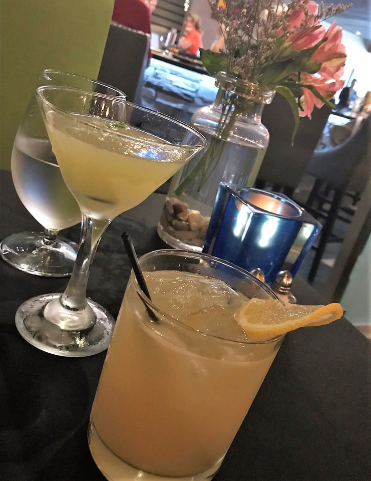 Photo - Cocktails from Piatto Italian Kitchen include the Gimme Lemon, right, and Signature Daiquiri. Each include house-made limoncello. [Dave Cathey/The Oklahoman]