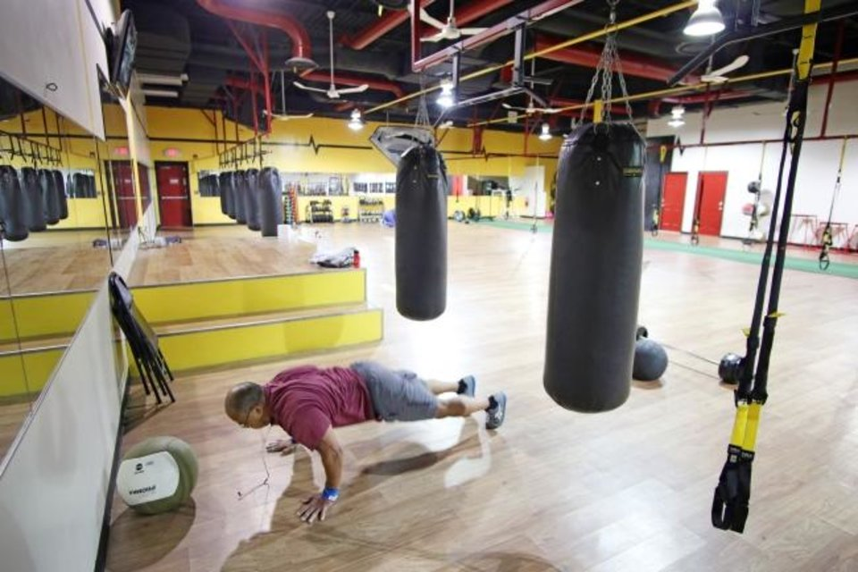 Photo -  Steve Retieffe works out at Steel Fitness and Tan in Norman, Friday, May 1, 2020. [Doug Hoke/The Oklahoman]