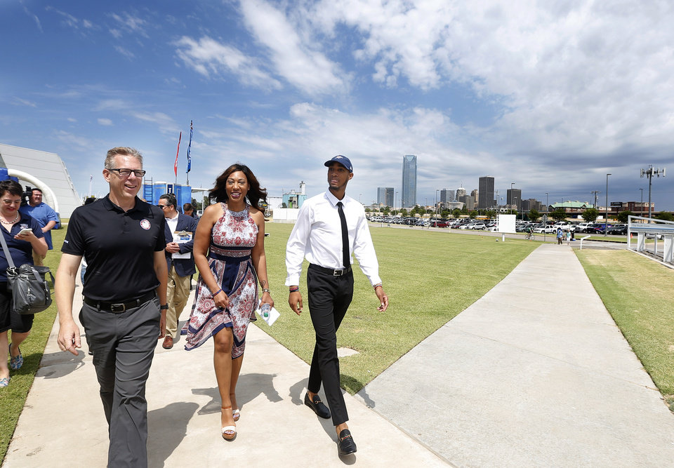 Photo - Oklahoma City's Terrance Ferguson tours Oklahoma City Boathouse district with his mom Rachelle Holdman and Micke Knopp following an introductory press conference a the CHK | Central Boathouse in Oklahoma City, Saturday, June 24, 2017. Photo by Sarah Phipps, The Oklahoman