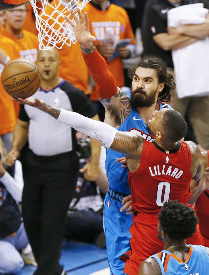 Photo - Oklahoma City's Steven Adams (12) defends Portland's Damian Lillard (0) late in the fourth quarter during Game 3 in the first round of the NBA playoffs between the Portland Trail Blazers and the Oklahoma City Thunder at Chesapeake Energy Arena in Oklahoma City, Friday, April 19, 2019. Oklahoma City won 120-108. Photo by Nate Billings, The Oklahoman