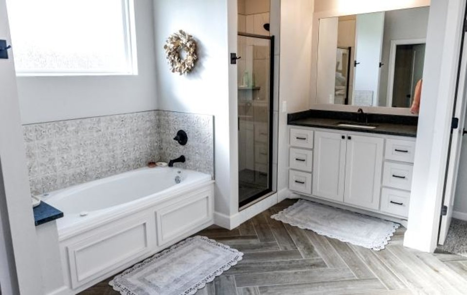 Photo -  Master bathroom at 10816 Blue River Drive in the Southfork at Surrey Hills addition, built by Capital Homes based on a the Winston, a 1920s Sears Roebuck and Co. catalog mail-order house. kit. [CHRIS LANDSBERGER/THE OKLAHOMAN]