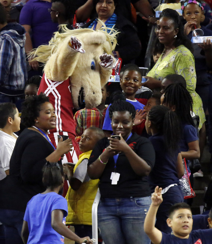 Photo - Oklahoma mascot Boomer interacts with fans during Final Four Friday before the national semifinal between the Oklahoma Sooners and the Villanova Wildcats in the NCAA Men's Basketball Championship at NRG Stadium in Houston, Friday, April 1, 2016. OU will play Villanova in the Final Four on Saturday. Photo by Nate Billings, The Oklahoman