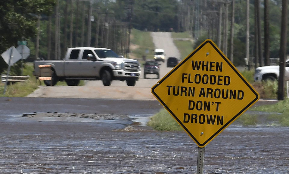 Photo - Traffic turns around as flood water covers 13th street in Kingfisher, Okla., Tuesday, May 21, 2019. (Billy Hefton/Enid News & Eagle via AP)