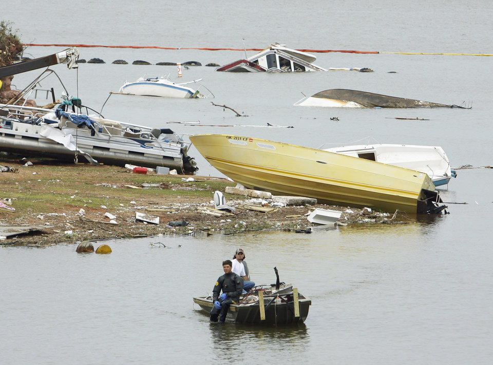 Photo - A salvage diver moves into position to recover boats and debris Wednesday. PHOTOS BY STEVE SISNEY, THE OKLAHOMAN