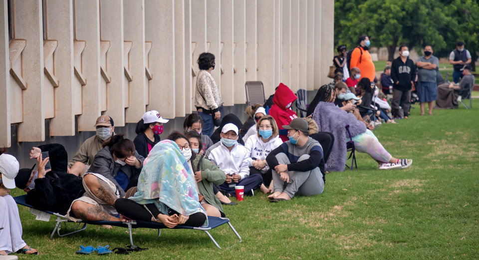 Photo - People, who began camping out 8pm Thursday evening, wait in line outside the Oklahoma Employment Securities Commission (OESC) to try and resolve issues that have prevented them from receiving unemployment payments on Friday, June 26, 2020, in Oklahoma City, Okla.   [Chris Landsberger/The Oklahoman]