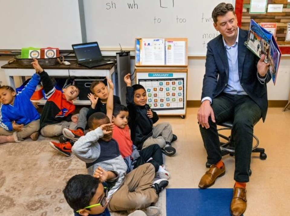 Photo -  Mayor David Holt reads the book 'Goodnight OKC' to Joscilyn Coleman's kindergarten class at Cesar Chavez Elementary in Oklahoma City, Okla Friday, Jan. 10, 2020.    [Chris Landsberger/The Oklahoman]