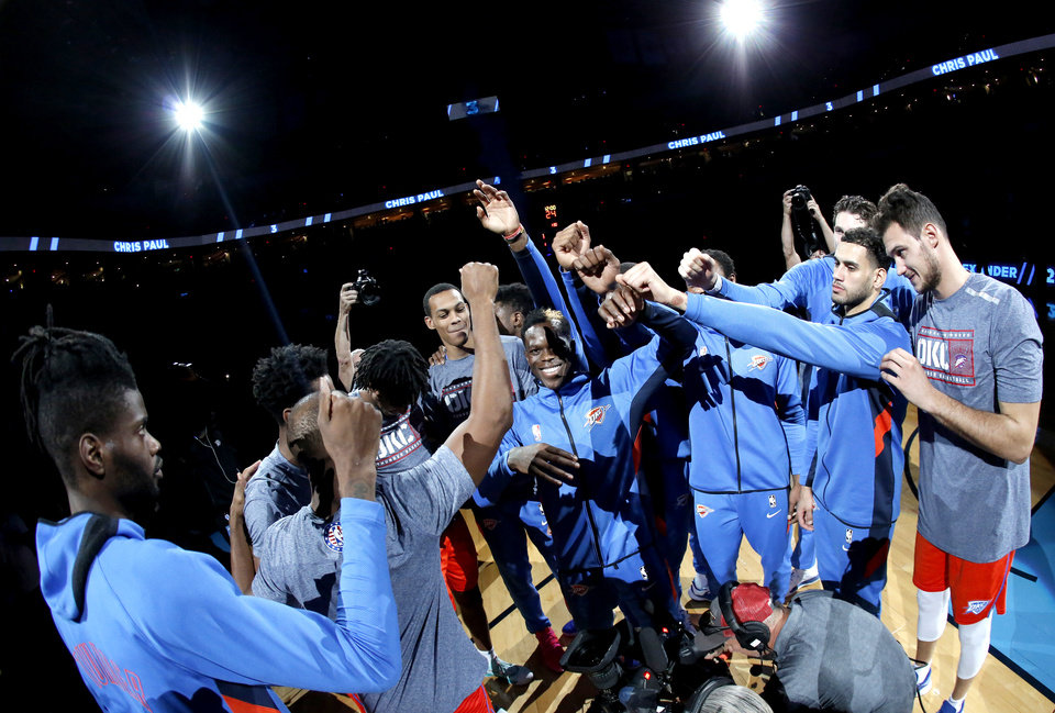 Photo - The Thunder huddle before the NBA game between the Oklahoma City Thunder and the Milwaukee Bucks at Chesapeake Energy Arena,   Sunday, Nov. 10, 2019.  [Sarah Phipps/The Oklahoman]