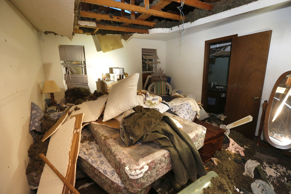Photo -  This is the bedroom of a home at 12501 Whispering Hollow Drive, next door to a home that was destroyed Saturday in a massive explosion. [Photo by Paul Hellstern, The Oklahoman]