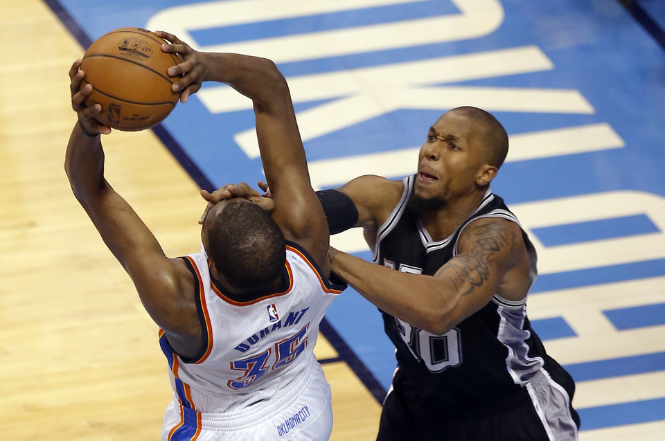 Photo - Oklahoma City's Kevin Durant (35) is fouled by San Antonio's David West (30) during Game 4 of the Western Conference semifinals between the Oklahoma City Thunder and the San Antonio Spurs in the NBA playoffs at Chesapeake Energy Arena in Oklahoma City, Sunday, May 8, 2016. Photo by Sarah Phipps, The Oklahoman