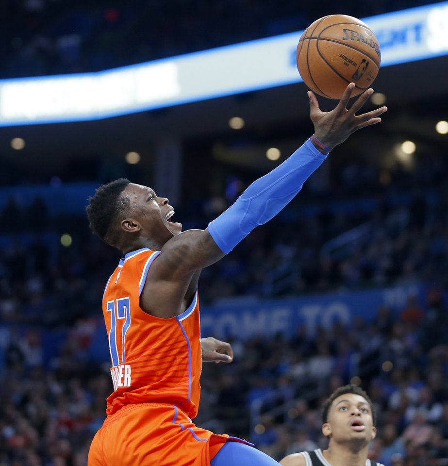 Photo - Oklahoma City's Dennis Schroder (17) goes to the basket during an NBA basketball game between the Oklahoma City Thunder and the San Antonio Spurs at Chesapeake Energy Arena in Oklahoma City, Sunday, Feb. 23, 2020. Oklahoma city won 131-103. [Bryan Terry/The Oklahoman]