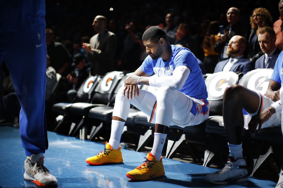 Photo - Oklahoma City's Paul George waits on the bench during player introduction before an NBA basketball game between the Oklahoma City Thunder and the Sacramento Kings at Chesapeake Energy Arena in Oklahoma City, Saturday, Feb. 23, 2019. Sacramento won 119-116. Photo by Bryan Terry, The Oklahoman
