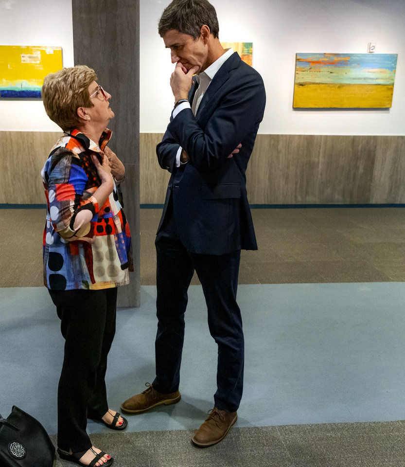 Photo - Democratic Presidential candidate Beto O'Rourke speaks to Melanie Hall after his press conference during a visit to the Oklahoma City National Memorial & Museum in Oklahoma City, Okla. on Monday, Aug. 19, 2019.  [Chris Landsberger/The Oklahoman]
