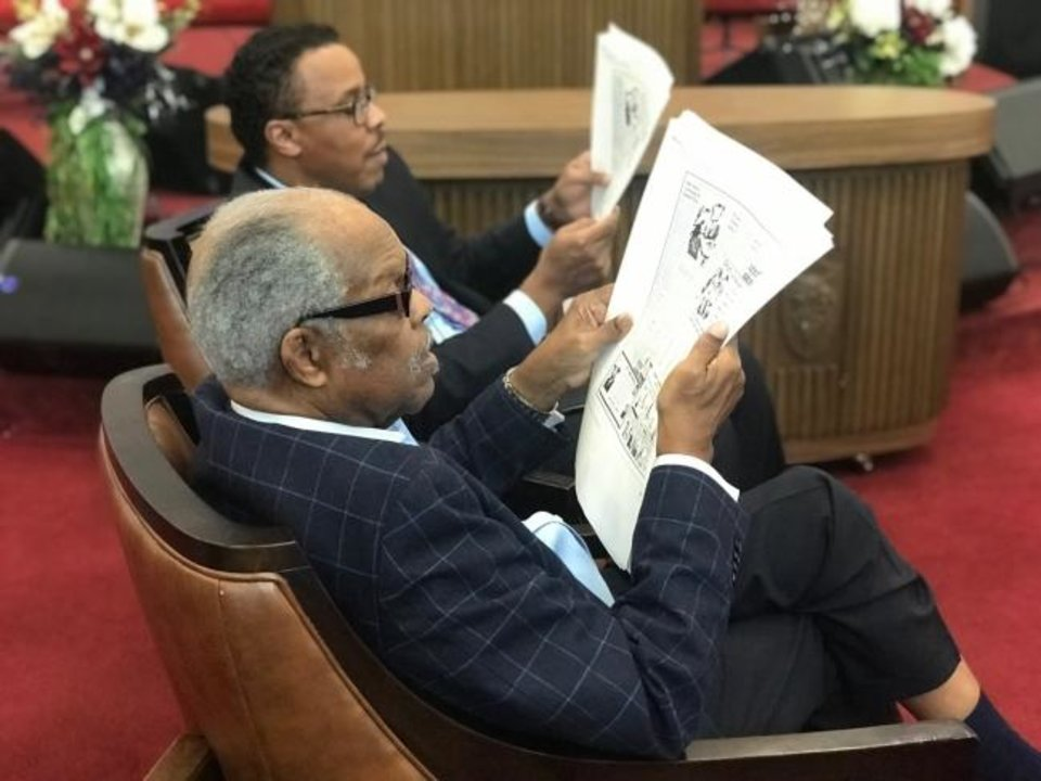 Photo -  The Rev. John A. Reed, front, and the Rev. Derrick Scobey, back, view vintage copies from The Oklahoman & Times at Ebenezer Baptist Church, 3600 N Kelley, where Scobey is senior pastor. [Carla Hinton/The Oklahoman]