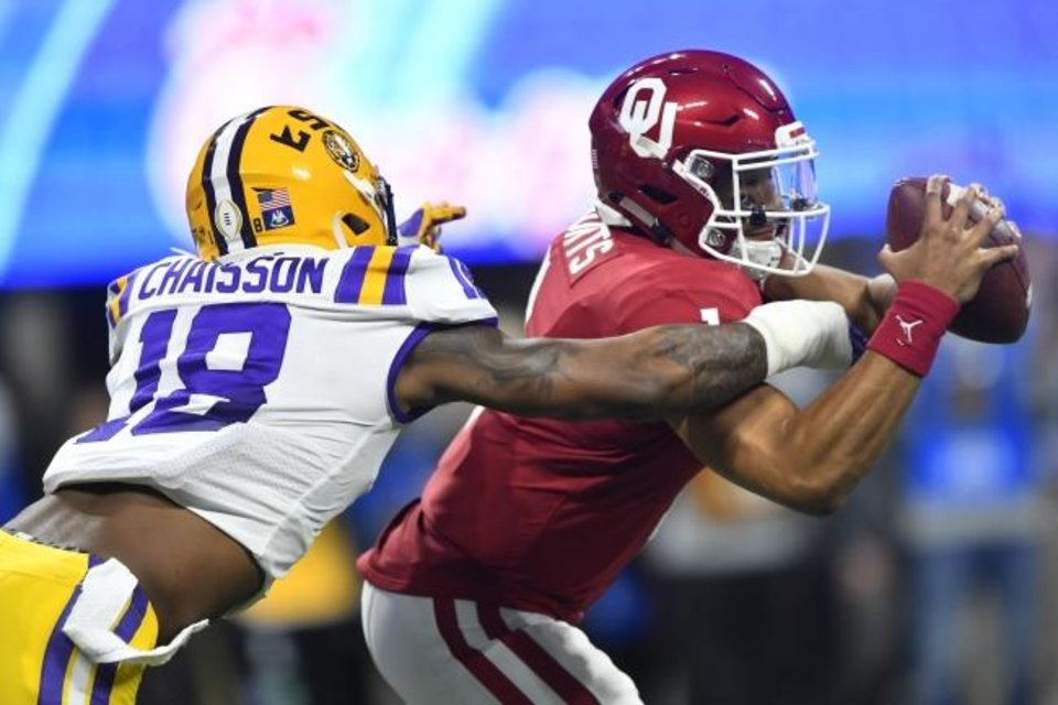 Photo -  LSU linebacker K'Lavon Chaisson (18) sacks OU quarterback Jalen Hurts during the first half of the Peach Bowl on Saturday. [AP Photo/John Amis]