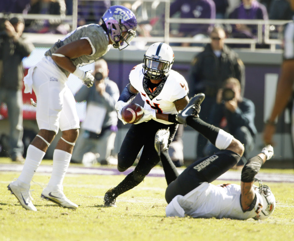 Photo -  OSU's Lenzy Pipkins, center, intercepts a pass during the second half of Saturday's game against TCU in Fort Worth, Texas. [PHOTO BY STEVE SISNEY, THE OKLAHOMAN]