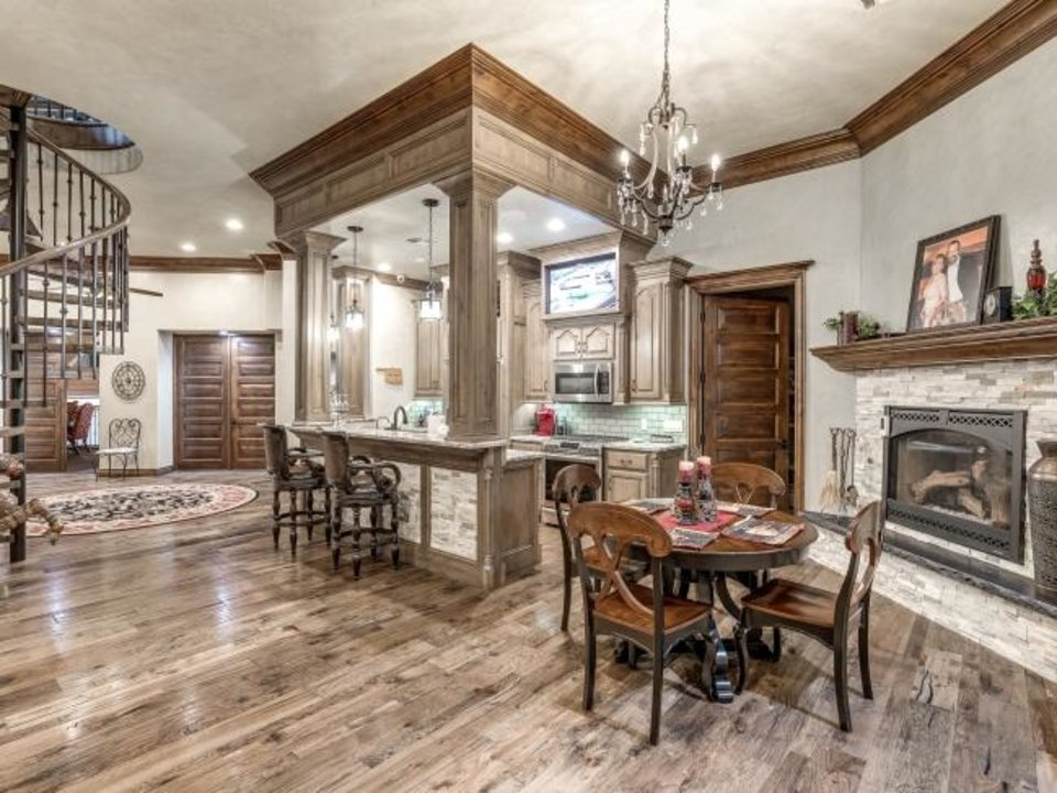 Photo -  Open kitchen and dining area of Milam Castle, 6424 SW 104, to be sold by auction on Halloween. [PHOTO PROVIDED/SUPREME AUCTIONS]