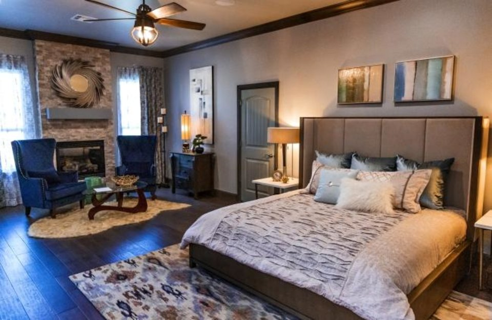 Photo -  The master bedroom in The Sparrow Show Home is decorated by Huff & Co. Designs. [CHRIS LANDSBERGER/THE OKLAHOMAN]